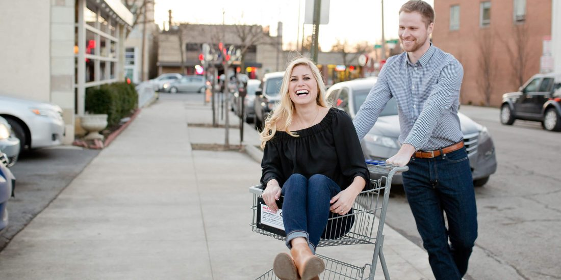 engaged couple in grocery cart