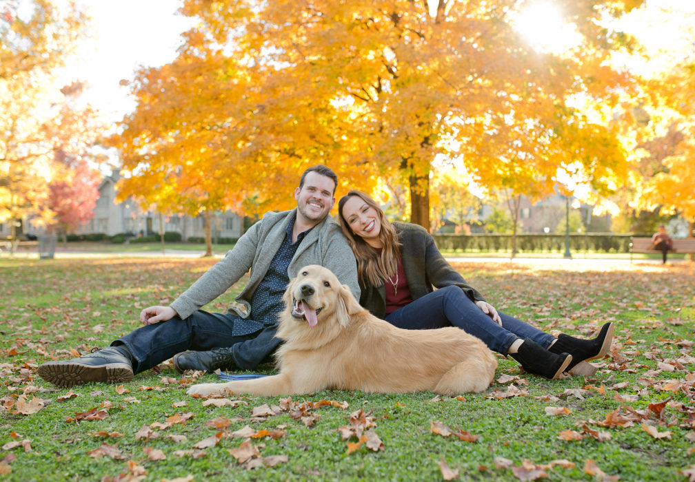 engaged couple in park with dog