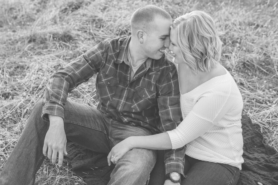 engaged couple cuddling at columbus ohio farm