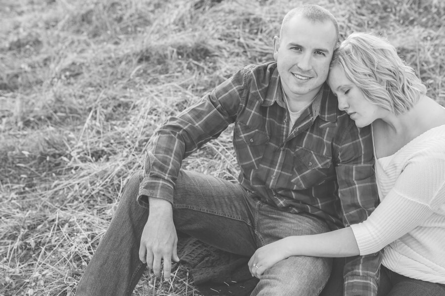 engaged couple snuggling at columbus ohio farm