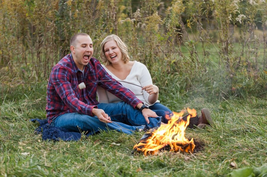 engaged couple feeding each other marshmallows
