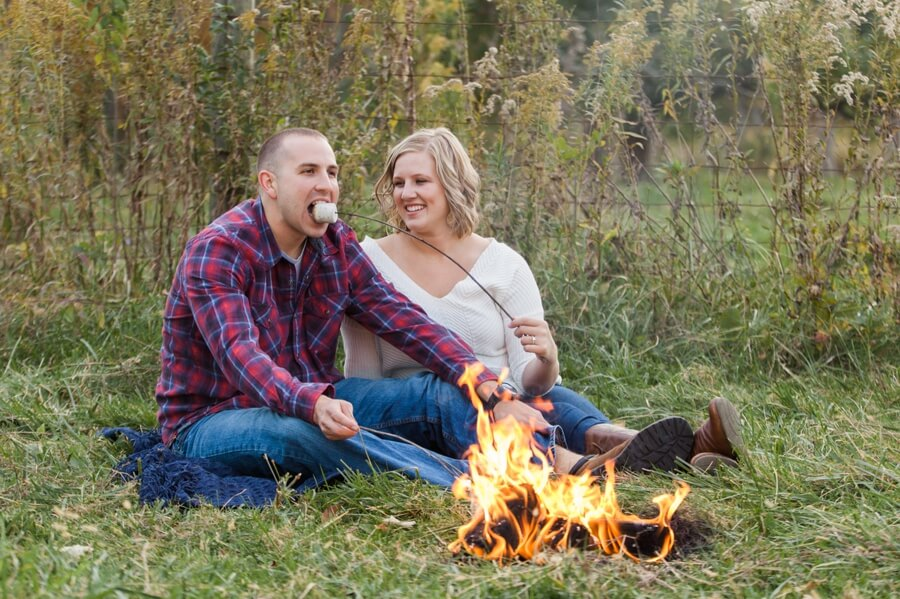 engaged couple eating marshmallows at columbus ohio farm