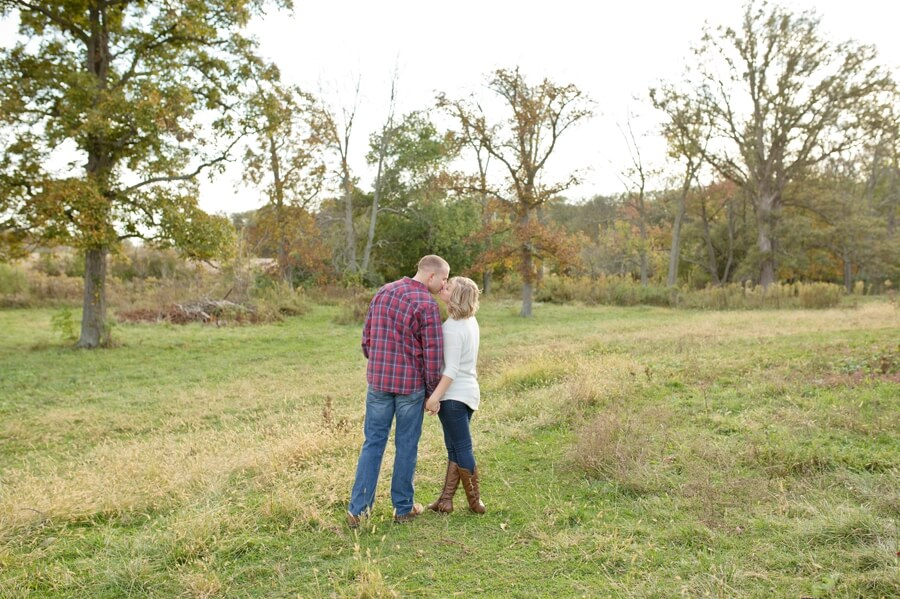 engaged couple kissing at columbus ohio farm