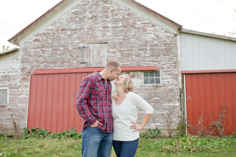 engaged couple laughing at columbus ohio farm