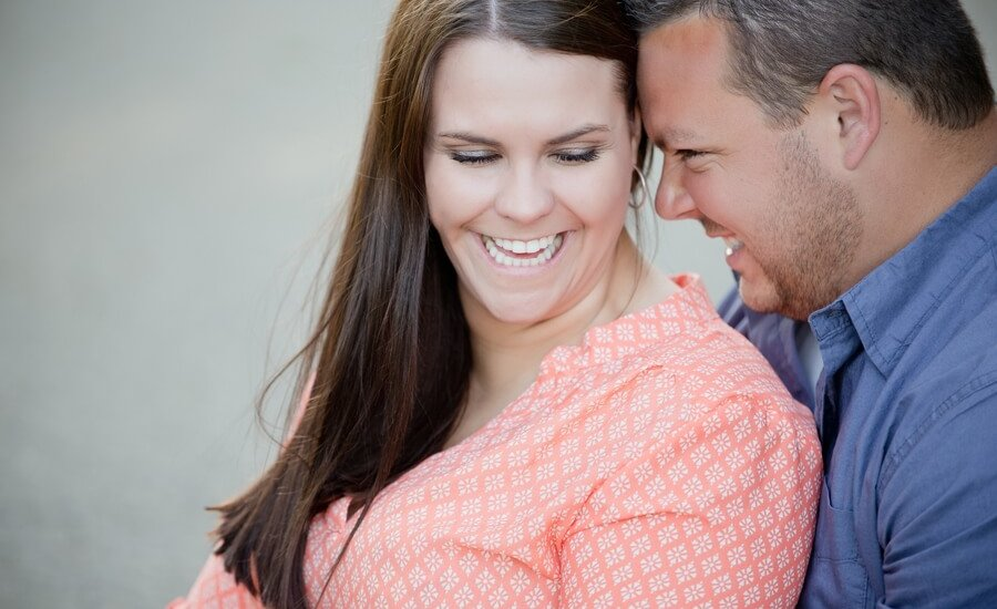 engaged couple snuggling at Irongate Equestrian Center
