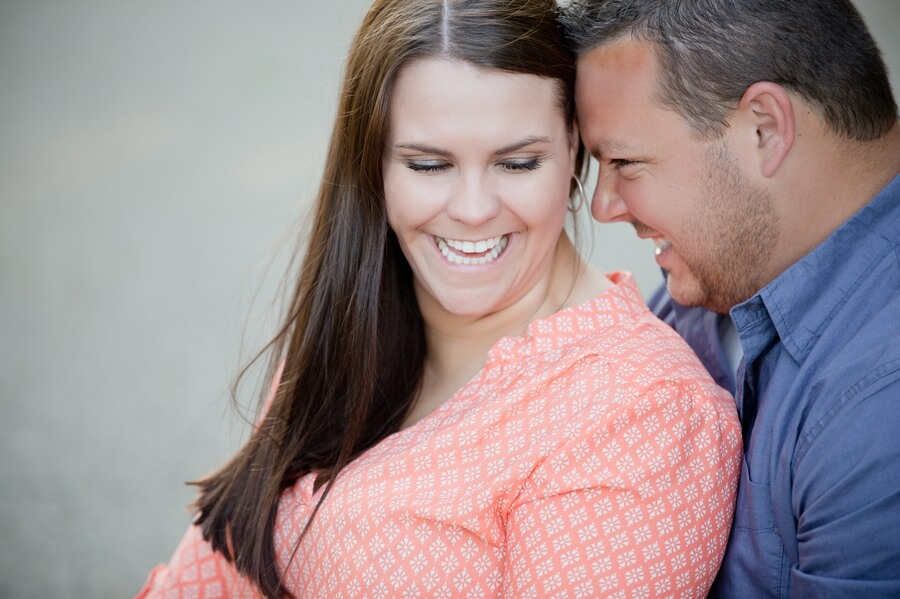 engaged couple snuggling and laughing