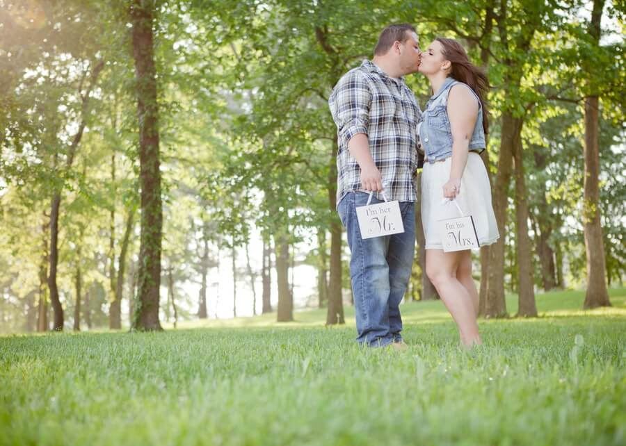 engaged couple kissing at Irongate Equestrian Center