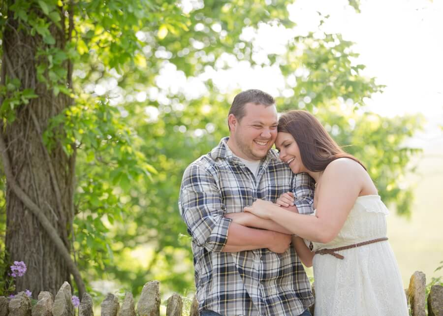 engaged couple laughing at Irongate Equestrian Center