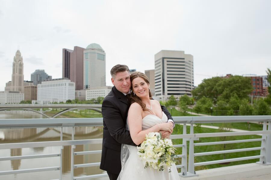 bride and groom at columbus skyline