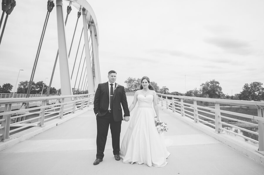 bride and groom holding hands at scioto mile