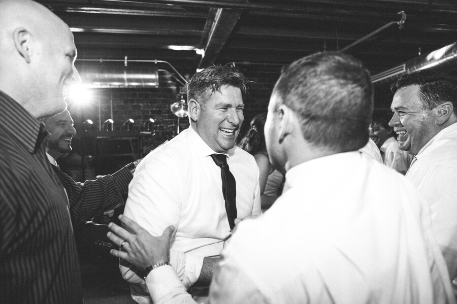 groom laughing at dock 580