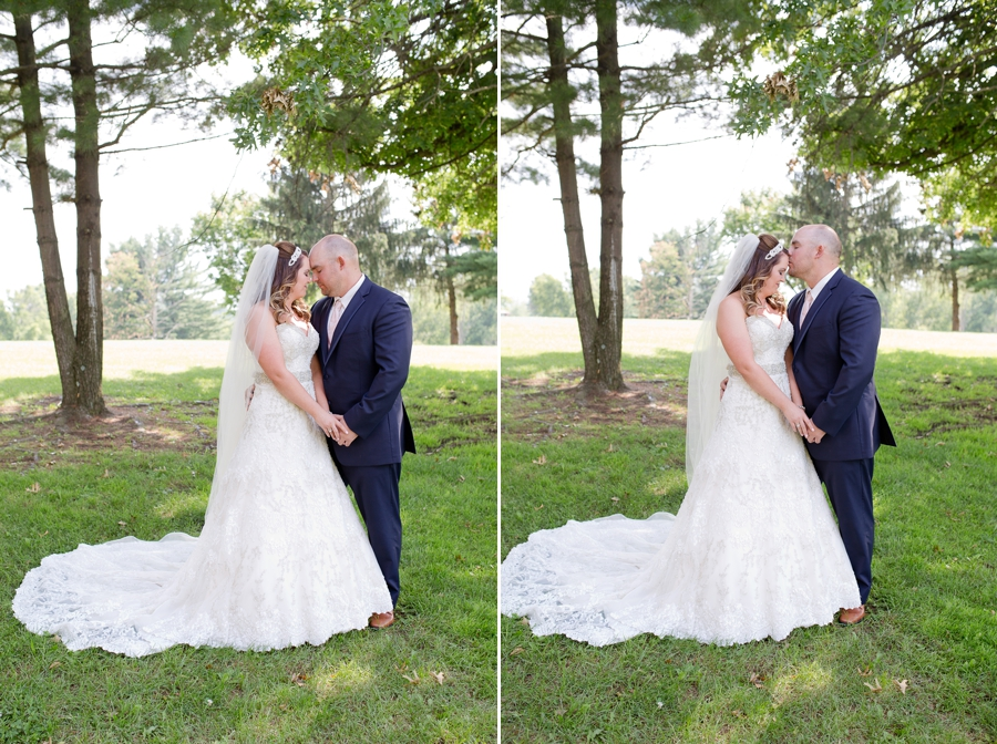 groom kissing bride on forehead at grand vue park