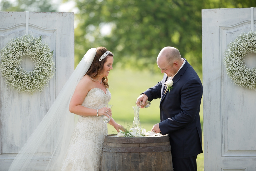 bride and groom pouring sand at ceremony
