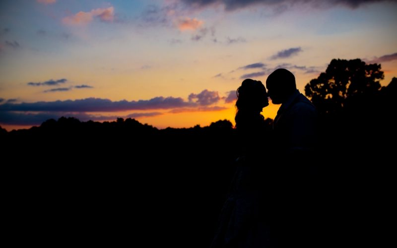 silhouette of bride and groom at grand vue park