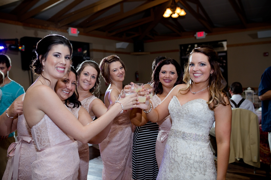 bride drinking shots at reception