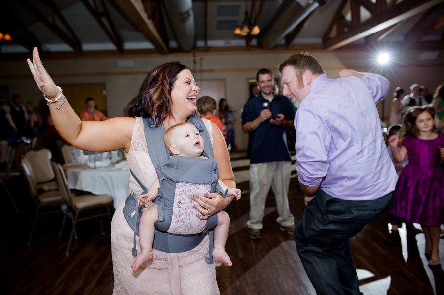 bridesmaid dancing with baby