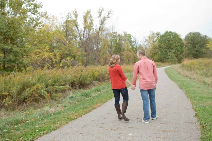 engaged couple holding hands at Highbanks Metro Park