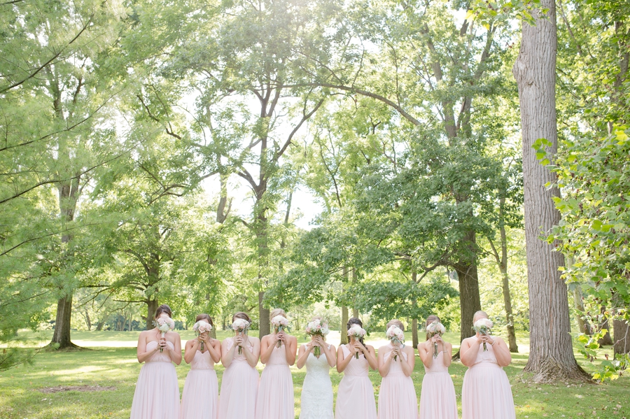 bride and bridesmaids with bouquets at the darby house