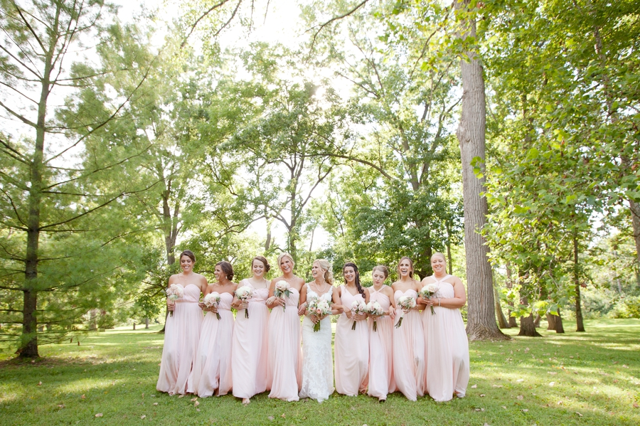 bride walking with bridemaids at the darby house