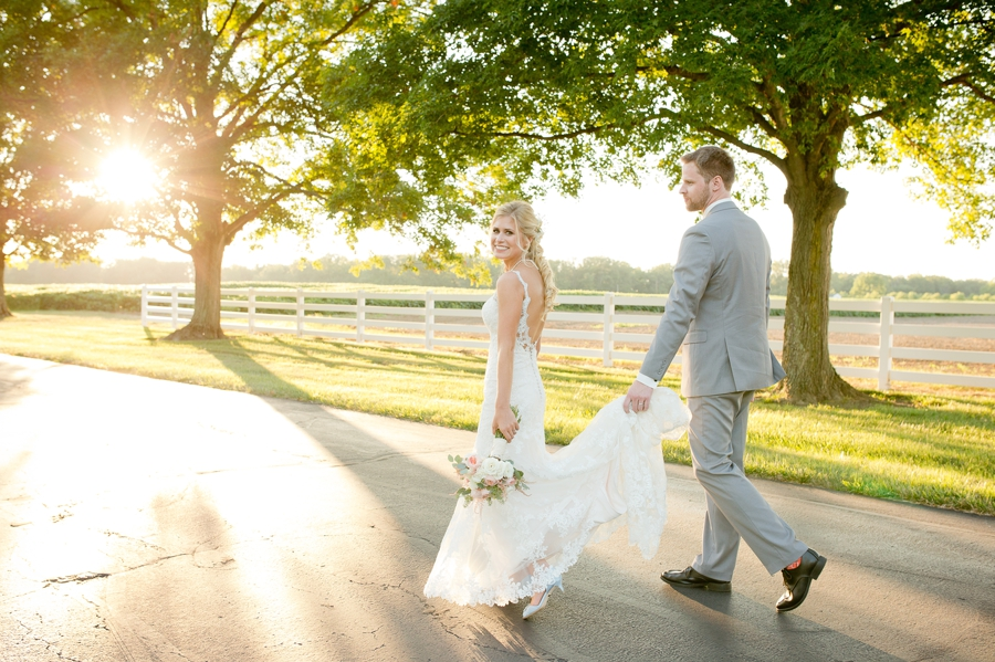 groom carrying brides dress