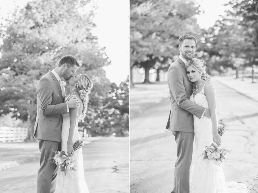 bride and groom kissing and hugging