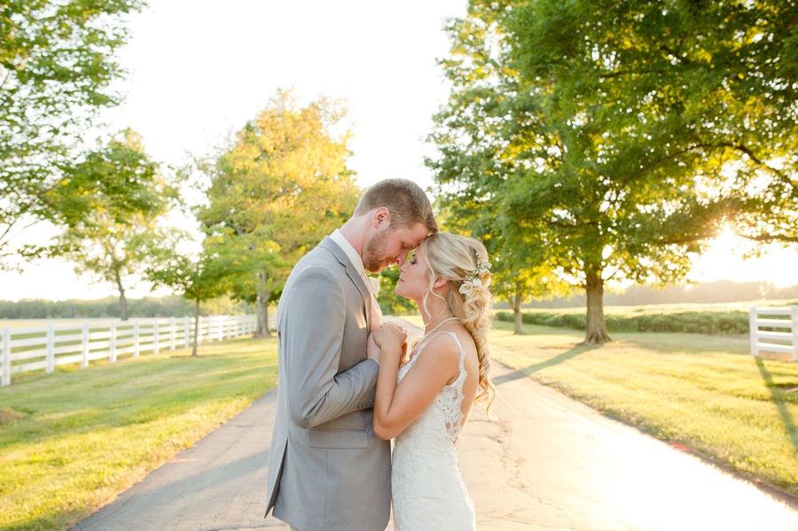 bride and groom holding hands at sunset at the darby house