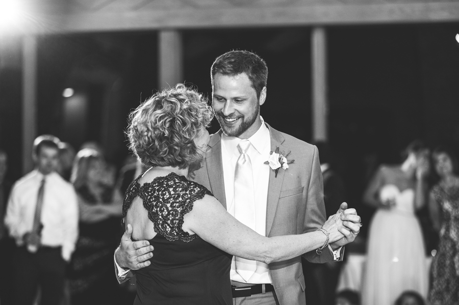 groom dancing with mother