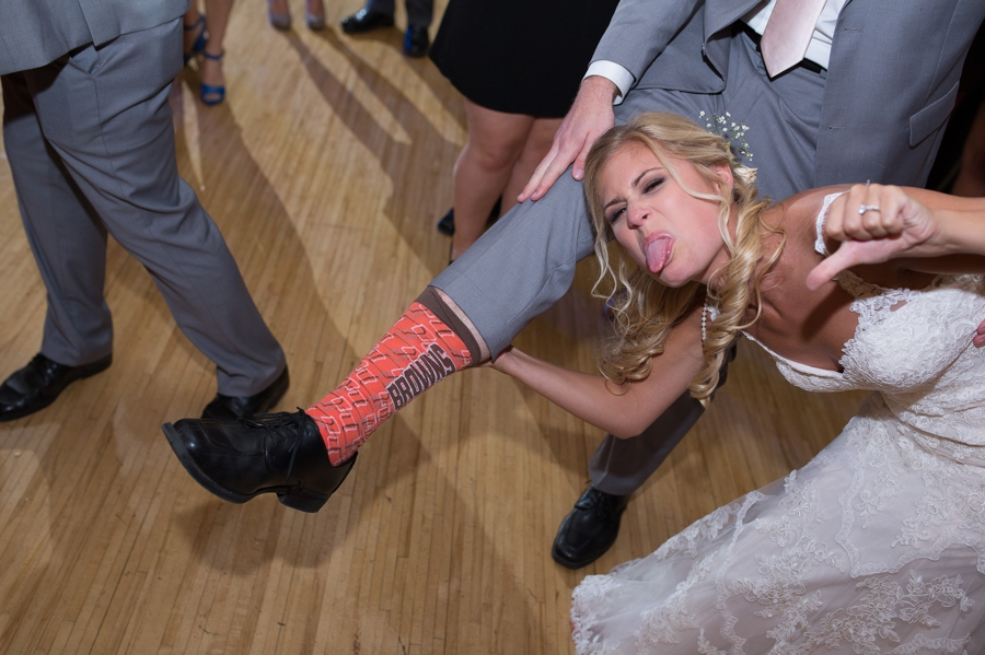 bride making face towards the brown socks