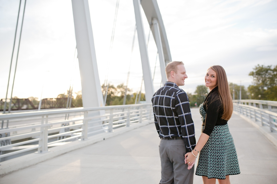 engaged couple on scioto mile bridge