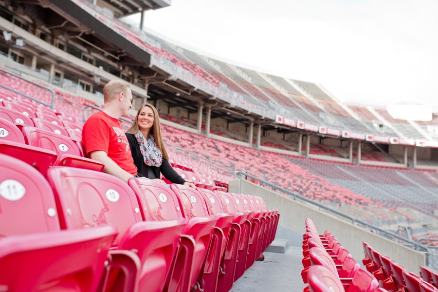Ohio State University Engagement couple sitting in stadium