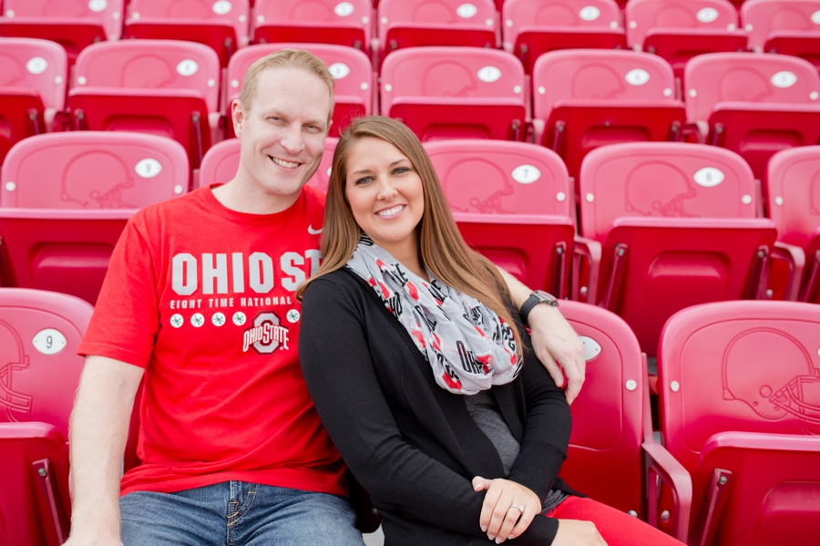 engaged couple cuddling at Ohio State University stadium