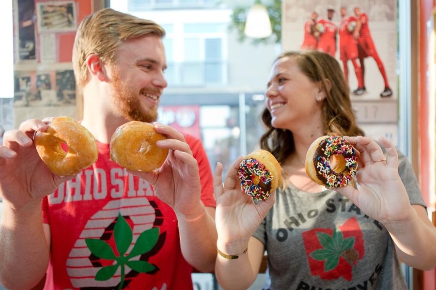 engaged couple with donuts at buckeye donuts