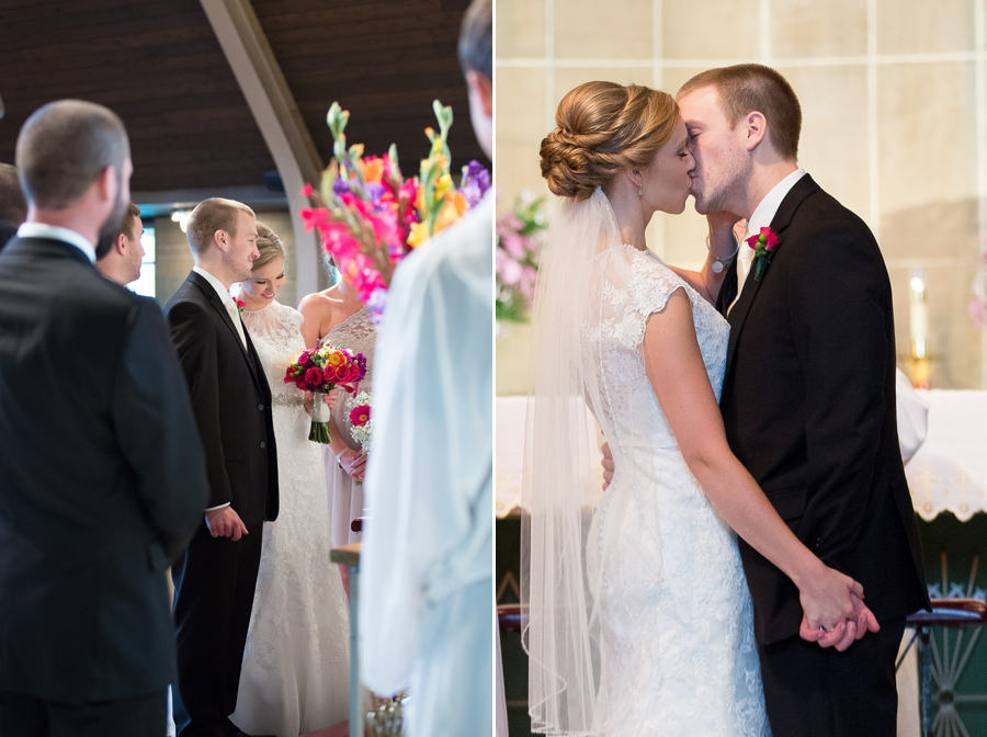 bride and groom first kiss at St. Christopher Catholic
