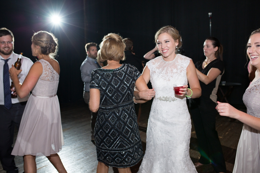 bride dancing with mom at wedding