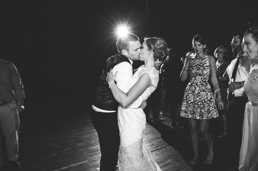 bride and groom kissing on dance floor at The Columbus Athenaeum