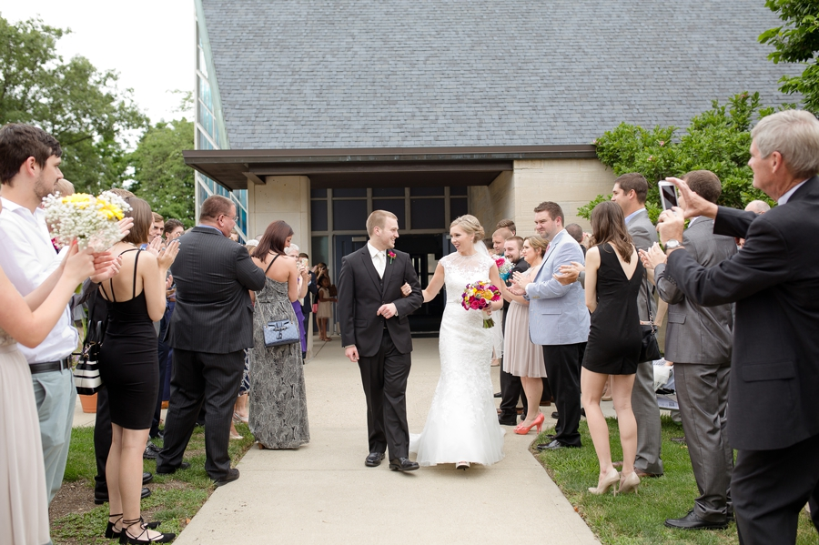 bride and groom exit at St. Christopher Catholic