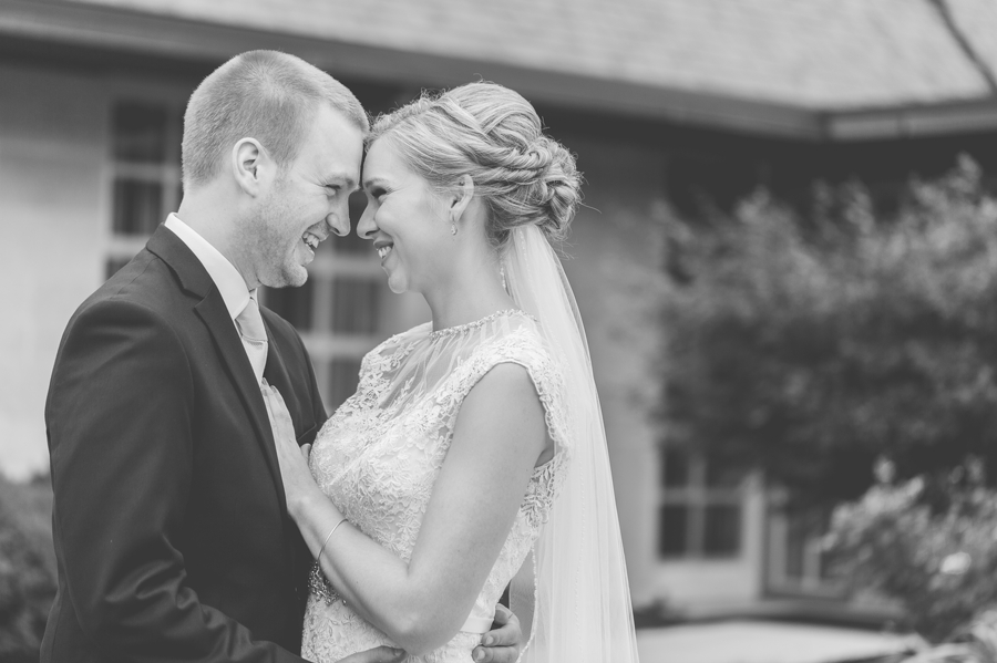bride and groom foreheads together