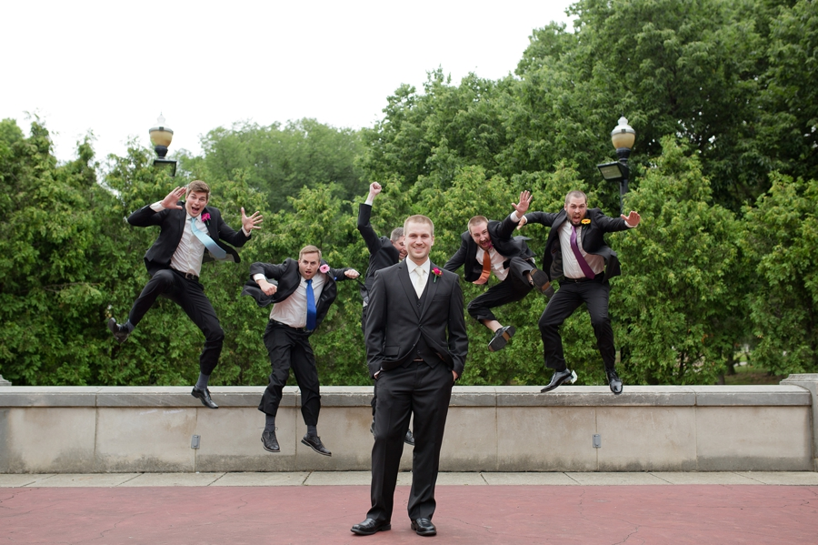 groom with jumping groomsmen