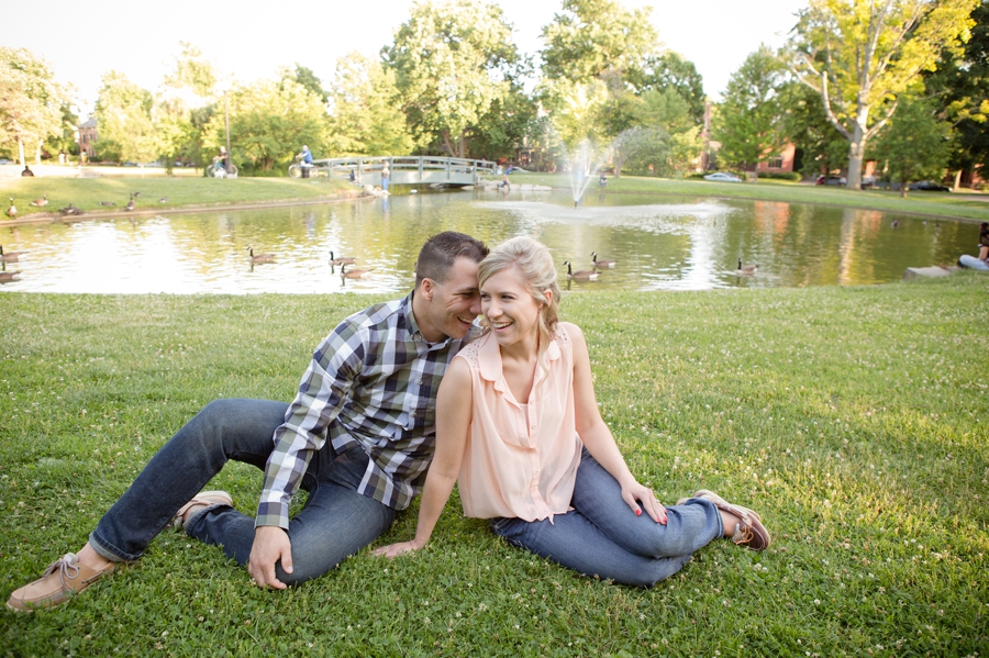 engaged couple sitting in front of Schiller Park pond