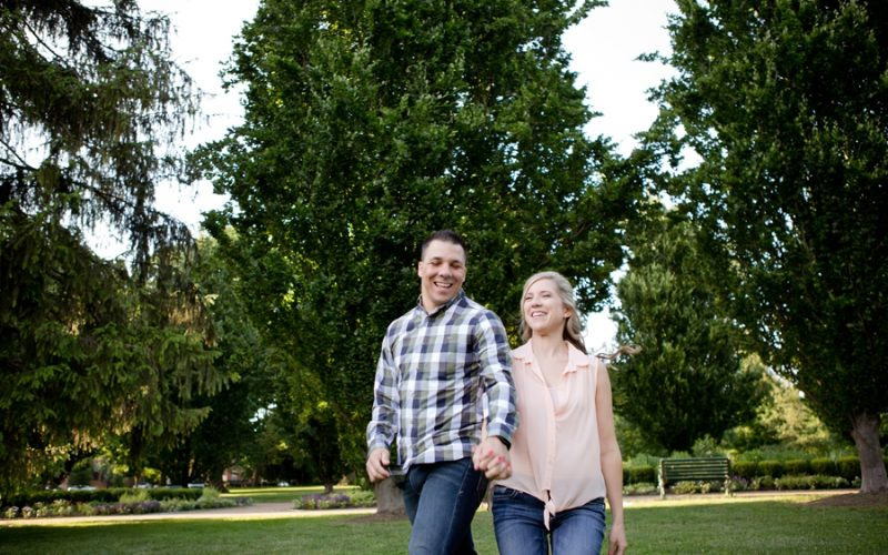 engaged couple running at Schiller Park