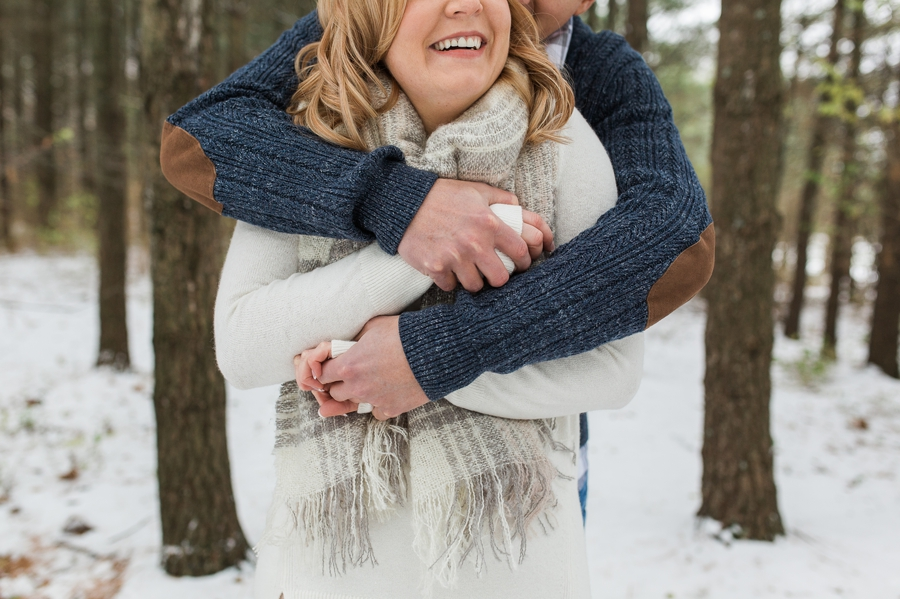 engaged couple wrapped in arms