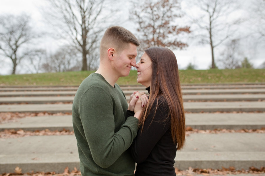 engaged couple eskimo kisses at Franklin Park Conservatory
