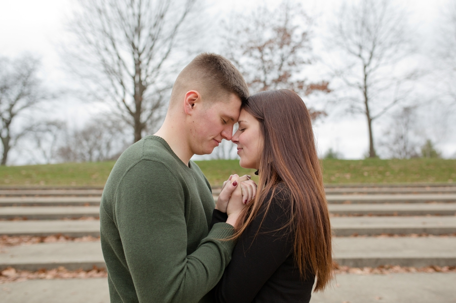 engaged couple with foreheads together