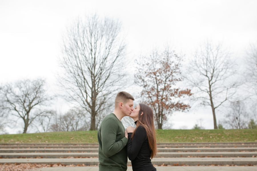 engaged couple kissing at Franklin Park Conservatory