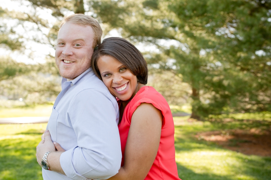 engaged couple cuddling at Ryland Lakes Country Club