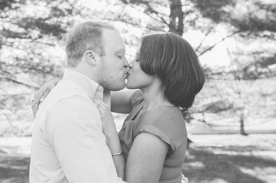 engaged couple kissing at Ryland Lakes Country Club