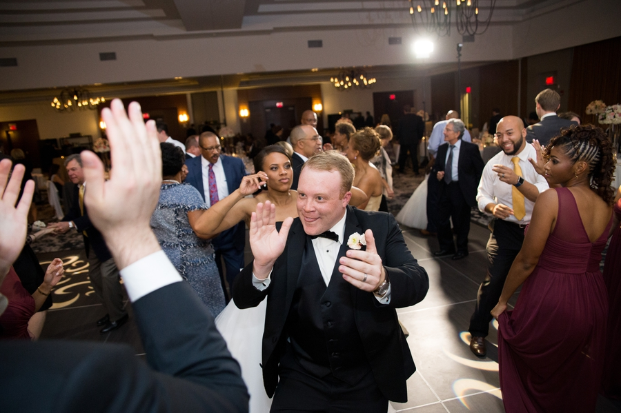 groom clapping hands during reception