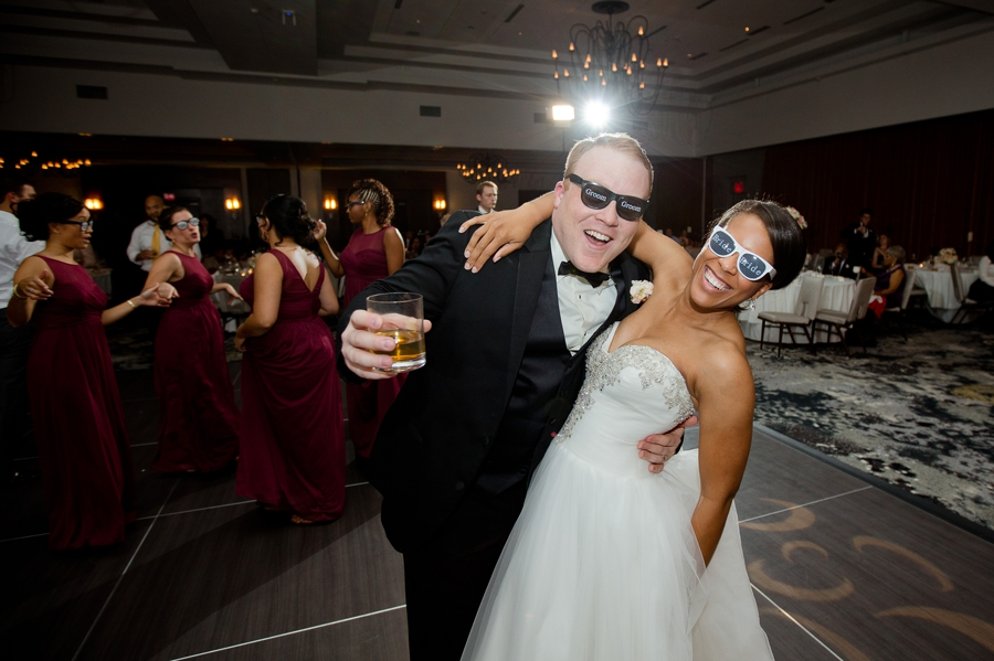 bride and groom wearing sunglasses at The Hilton Downtown Columbus