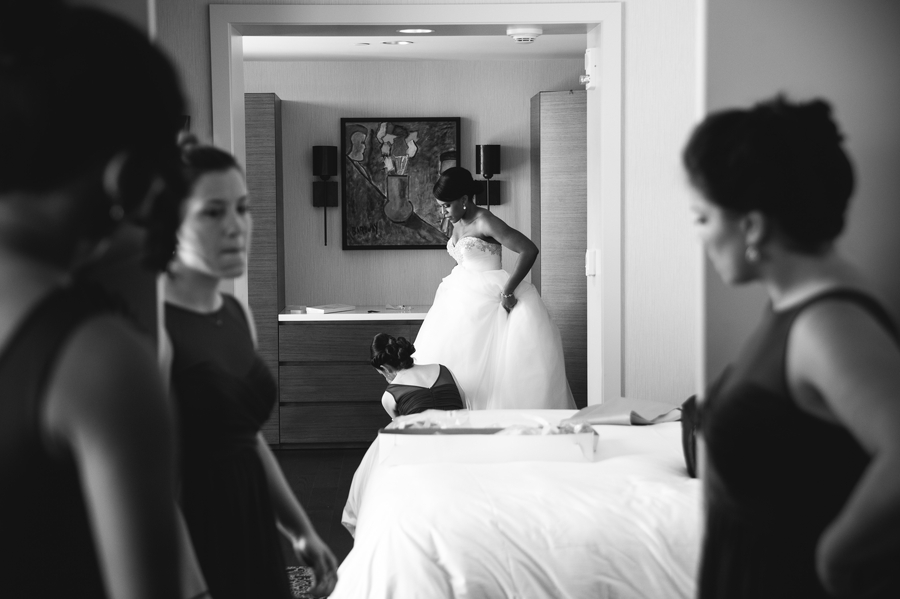 bride getting dressed at The Hilton Downtown Columbus