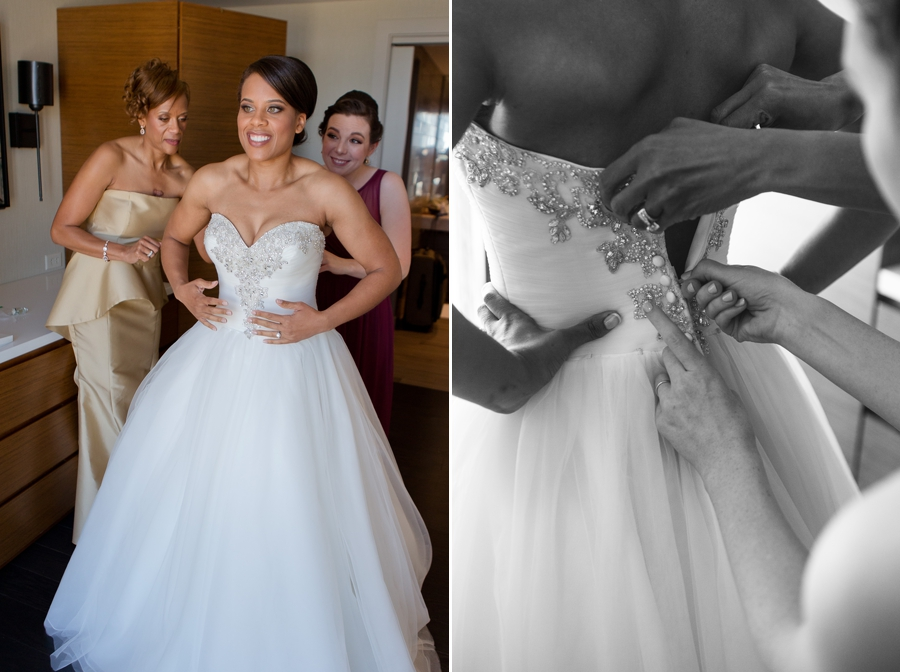 mother of bride helping bride get into gown